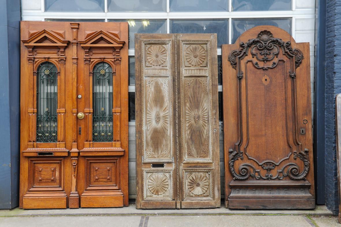 Rijk gedetailleerde antieke voordeur uit een grachtenpand