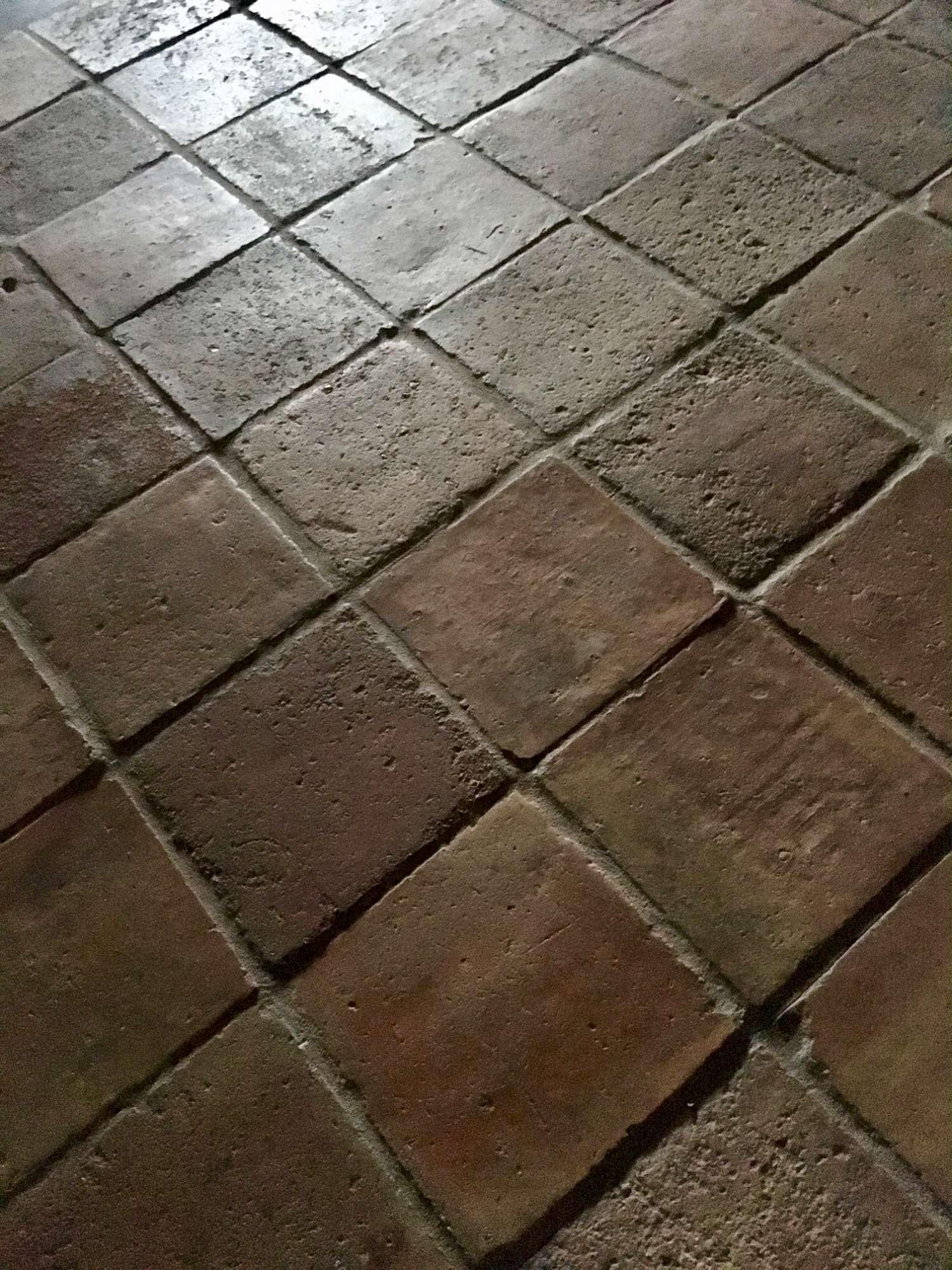 Antieke terracotta plavuizen