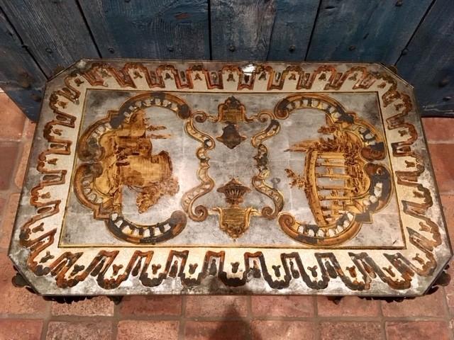 Design tafeltje gedecoreerd met achterglasschildering en bladzilver