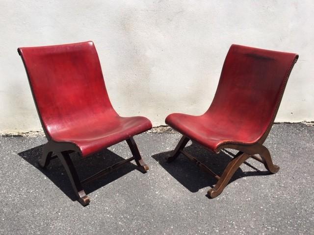 twee-rode-slipper-chairs-van-pierre-lottier-voor-valenti