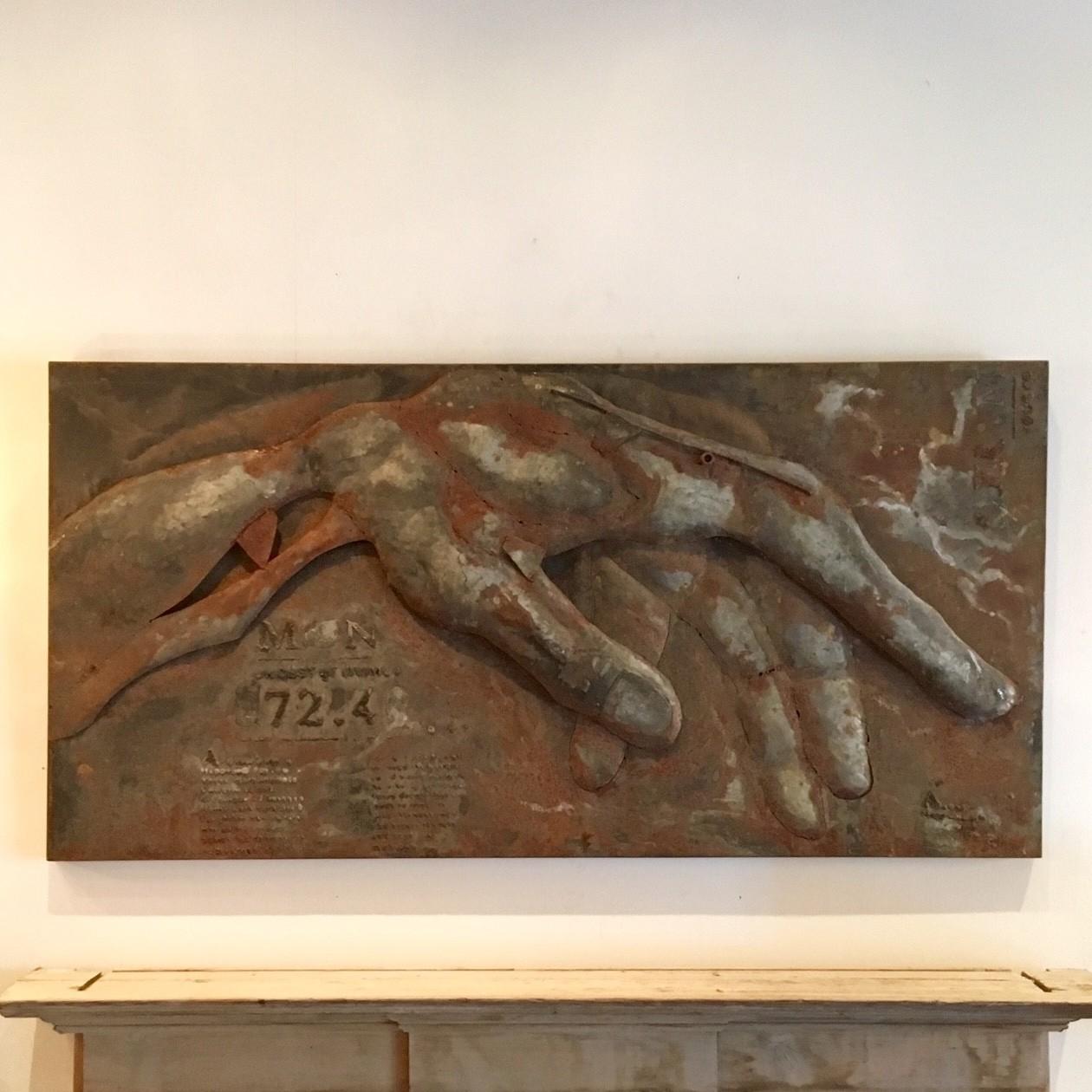 Roestig wandsculptuur naar voorbeeld van Michelangelo