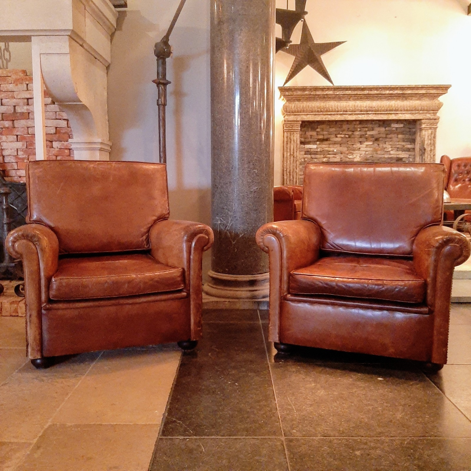 Stel oude  lederen club  chairs